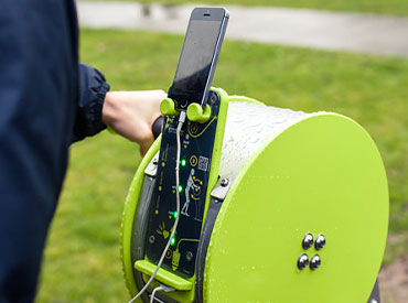 chargin phone on an outdoor gym equipment