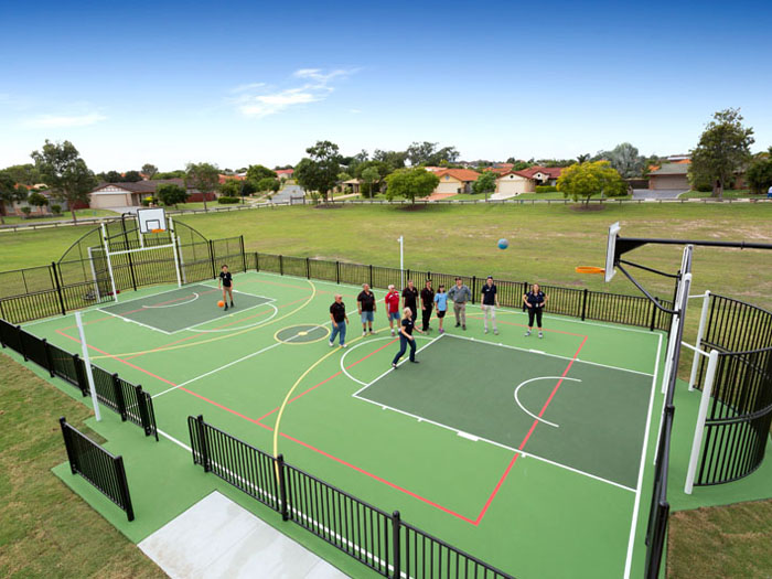 multi sports court in black with basketball and football goal ends