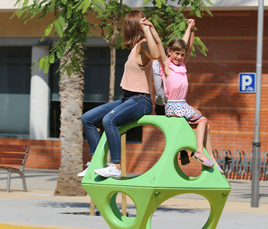 mother and daughter playing on a playground PlayCube structure