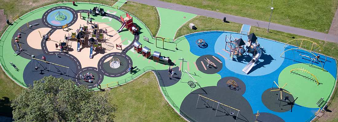 Playground in Scotland with different colours of surfacing on each play area