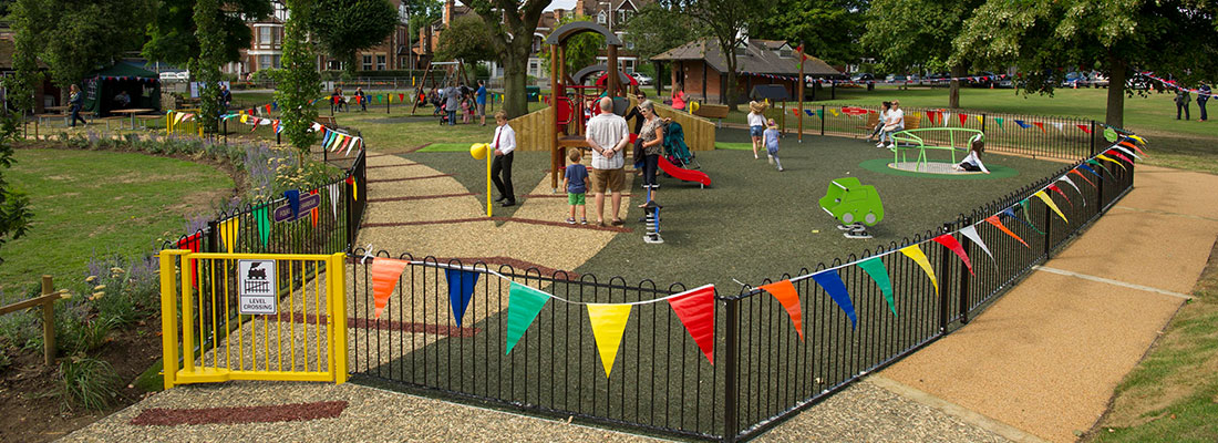 Playground with fencing and yellow gate