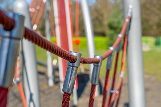 steel and red rope on a playground net bridge